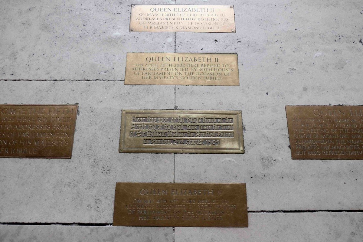 The Palace of westminster and parliament tour bronze plaque the queen stood here