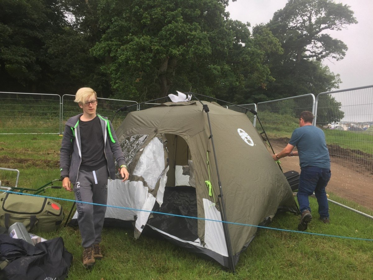 pop up tent camping at a festival in the rain