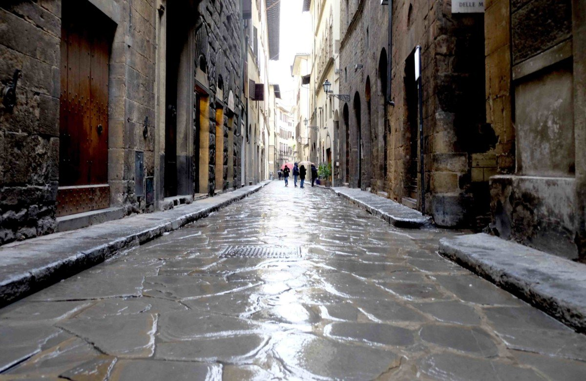 Florence rain reflection on the street Day trip Gelato making in florence with Livitaly