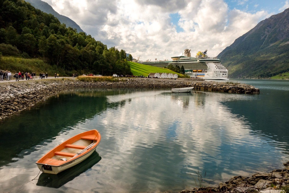 Stunning view of Skjolden in the Norwegian Fjords with the Independence of the Seas in the background
