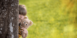 child with teddy
