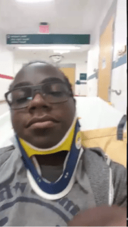 Me waiting around in the hospital hallway. The neck brace was a 'precautionary measure'.