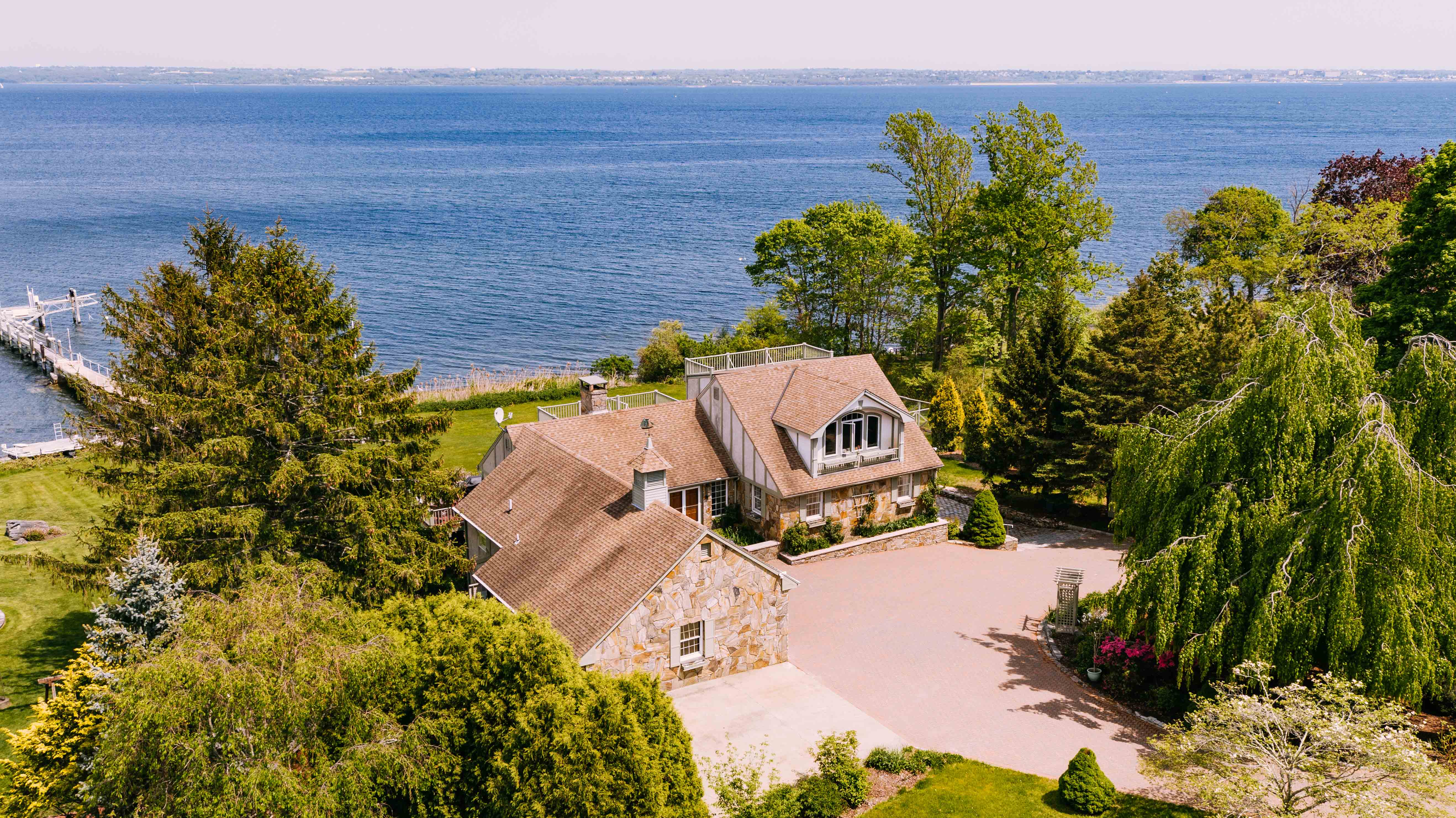 WATERFRONT CONTEMPORARY TUDOR ON JAMESTOWN'S EAST SHORE ROAD SELLS FOR $2.35M
