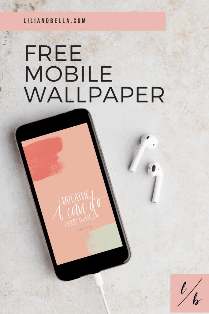 Free wallpaper with a motivational quote on a mobile device.