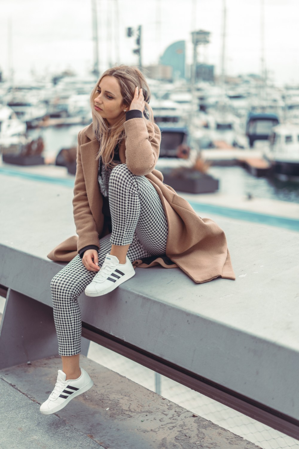 wearing uniqlo sweatshirt checkered pants adidas white sneakers pinko coat barcelona trip casual day ootd blonde girl