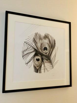 cadre artiste plume de paon noir et blanc