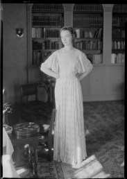 Nell Dorr (1893-1988); [Lillian Gish, beads in hair, standing in library with hands on hips]; nitrate negative; Amon Carter Museum of American Art; Fort Worth TX; P1990.47.3510