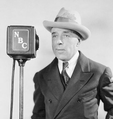 """(Original Caption) D.W. Griffith, early genius of Hollywood and creator of many important phases of modern screen techniques, now devotes his voice and directing skill to """"D.W. Griffith's Hollywood,"""" a radio review of the life and history of the film capital, heard over the NBC-WJZ network each Sunday and Wednesday at 10:00 p.m., E.S.T. Undated photograph."""