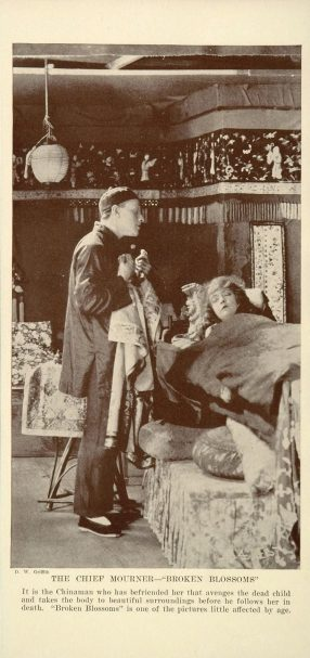 print of a scene from D.W. Griffith's Broken Blossoms (1919) with Lillian Gish as Lucy Burrows and Richard Barthelmess as the Chinaman Cheng Huan