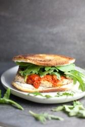 chicken parmesan sandwich on a gray plate