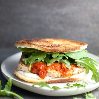chicken parmesan sandwich on a gray plate
