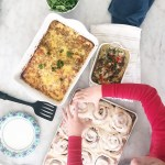 Breakfast casseroles and cinnamon rolls on the table