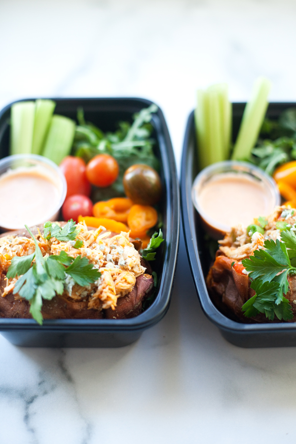 Lunch with baked sweet potato stuffed with creamy buffalo chicken and veggies on the side. www.lillieeatsandtells.com