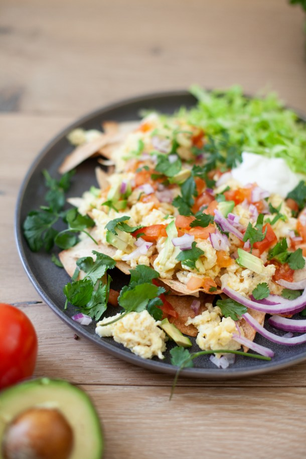 Nachos for breakfast. Eggs, cheese, and veggies is all you need. www.lilieeatsandtells.com
