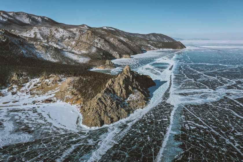 ridge against icy sea under blue sky
