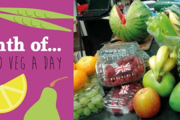 """Various fruit ready for smoothies with artwork stating """"a month of 5 fruit and veg a day"""