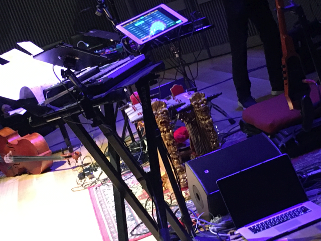 Laurie Anderson's stage set up including keyboards, tablet controllers and Apple laptop