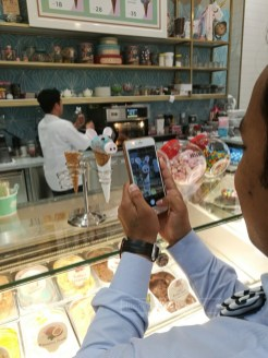 Rajesh taking a shot of the ice cream for the winners!