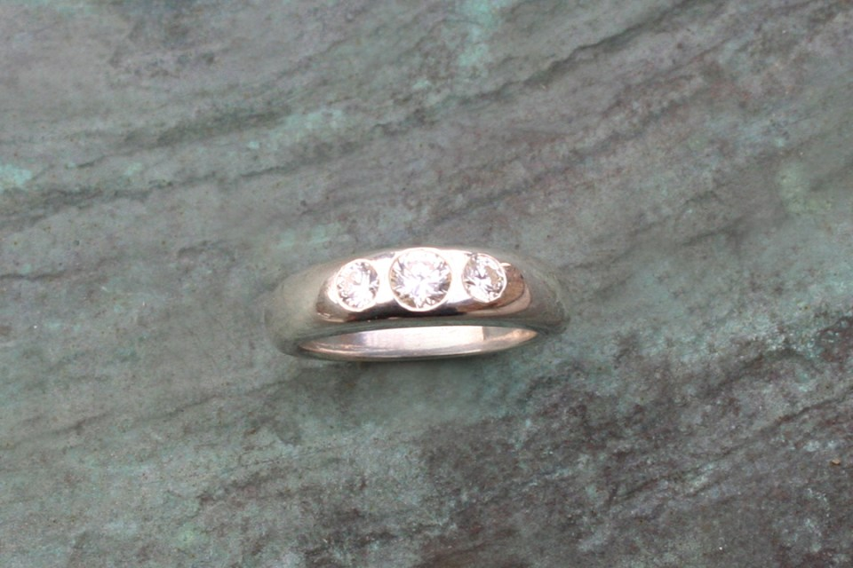 White Gold Engagement Ring With Three Gypsy Set Diamonds