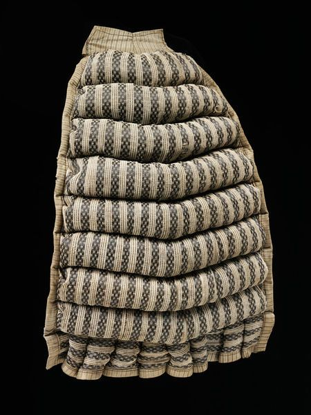 Bustle Pad, made from linen and stuffed with horse hair. Victoria & Albert Museum (T.57-1980)