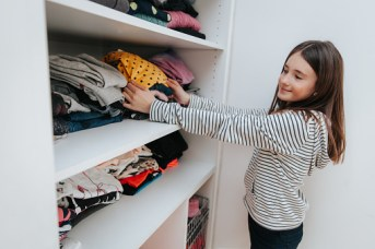 teen girl picking an outfit to wear