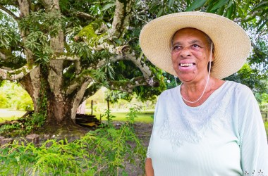 Miss Vange in her garden in Crooked Tree Belize.