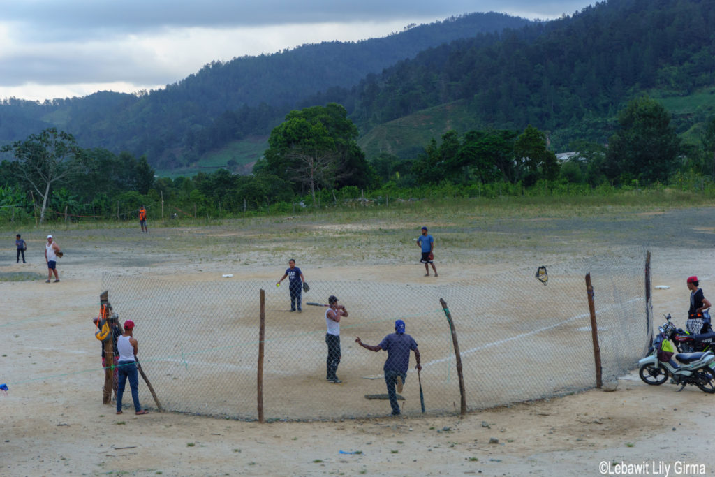 Boys playing baseball in Manabao, Dominican Republic.