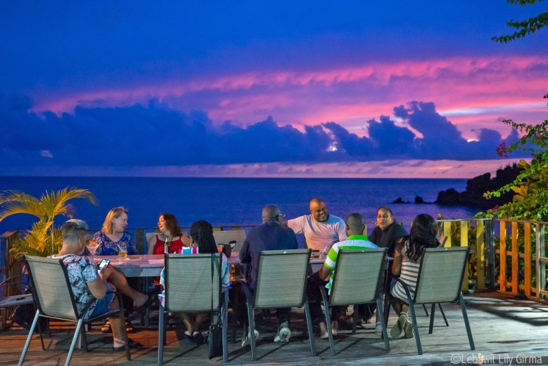 A table of 10 people dining seaside at Caribbean sustainable tourism conference 2019