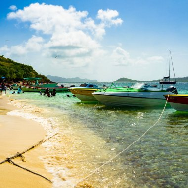 View of boats parked at the beach on Petit Bateau offshore island in Grenadines