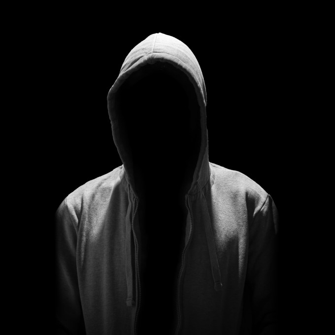 Portrait of Invisible man in the hood isolated on black background