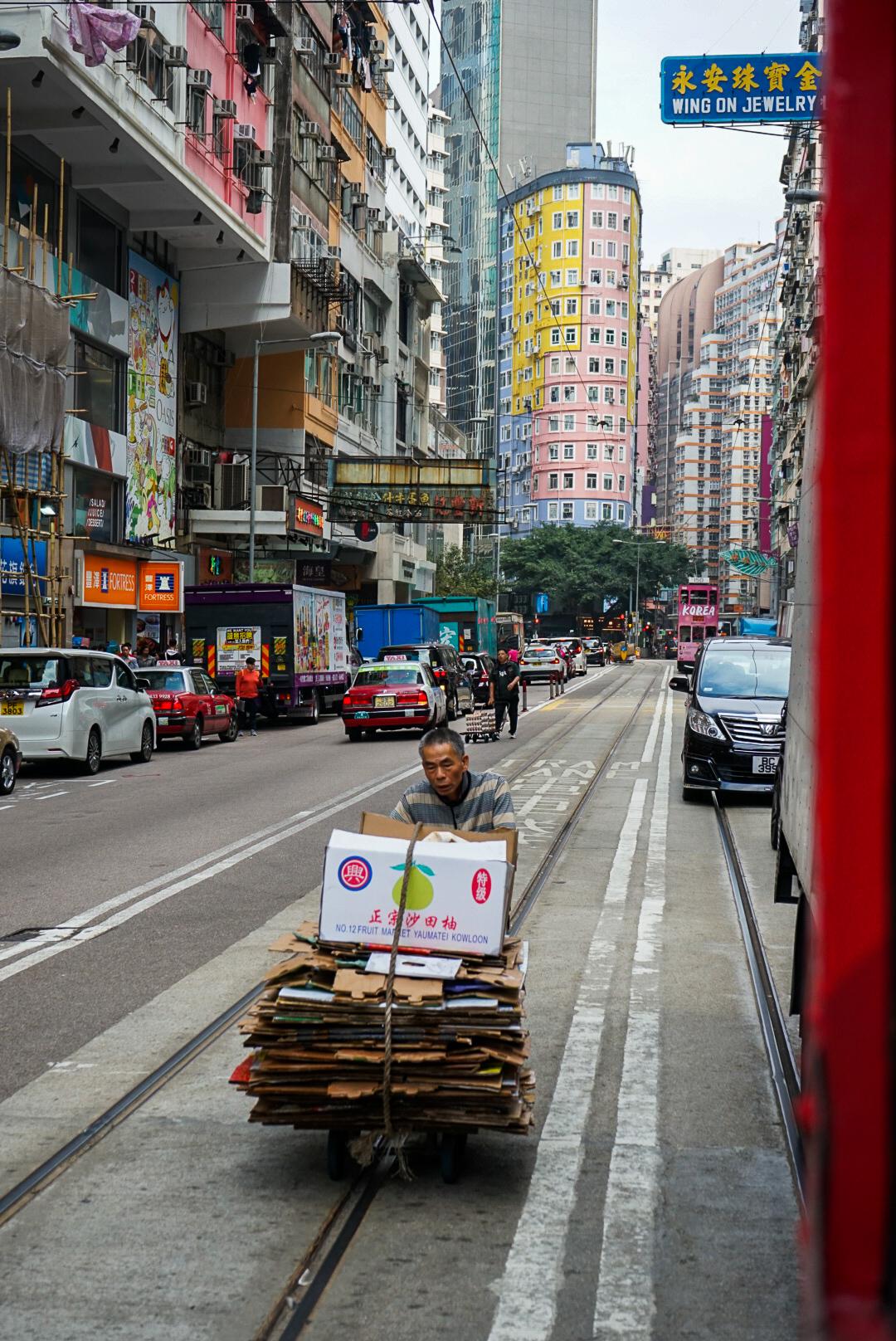 Man pushing cardboard trolley in Wan Chai Hong Kong