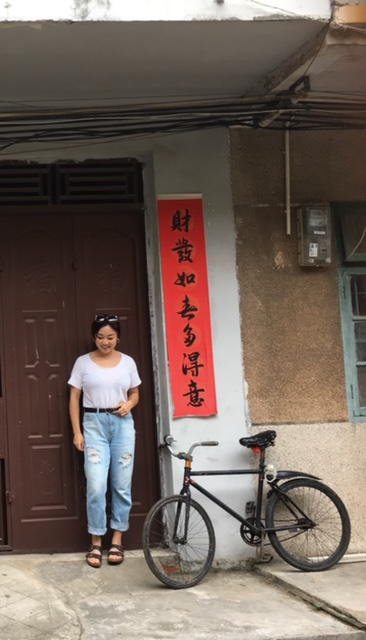 Standing in front of a home in Liuzhou