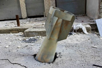 An unexploded ordnance is seen in the Ain Terma area in Ghouta, east of Damascus