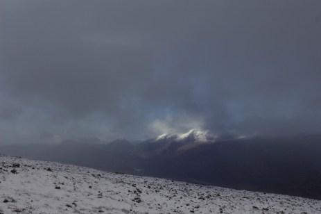 The peaks, peeking through the clouds.