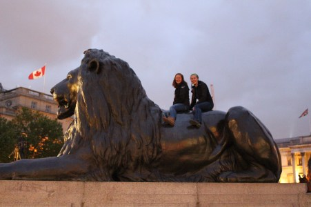 Last adventure together abroad calls for climbing on a brass lion.