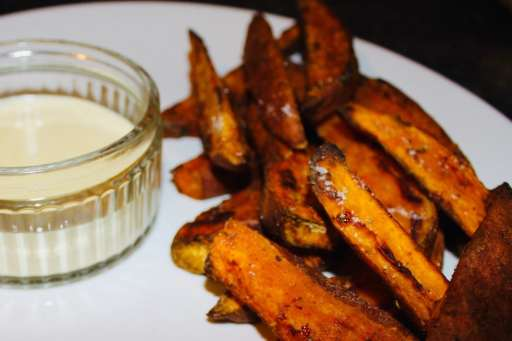 Yummy wedges on a white plate with garlic aioli