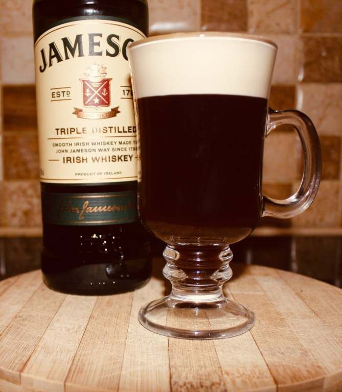 The best Irish coffee. Strong hot coffee with Jameson whiskey and a cream head in an Irish whiskey glass.