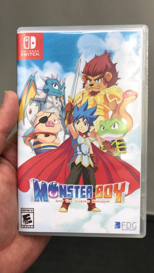 me holding the monster boy box at gamescom 2018