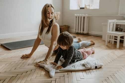 Mother and child doing a rainy day activity...yoga