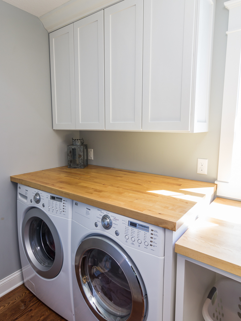 Laundry with folding surface and storage