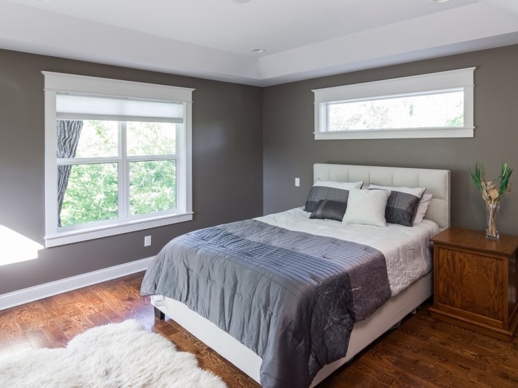Bedroom with high window for furniture placement