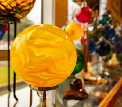 LCCC Gift Shop - yellow glass float on stand