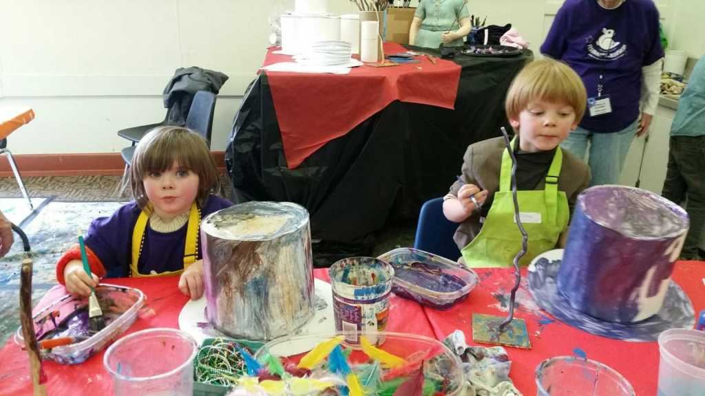 Two children making art with paint at the AbraCadabra workshop