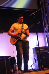 Accelerate Band Lead guitarist / vocals Jarryd Trokis playing his guitar on stage