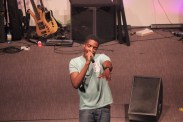 A photo of Guvna B during his performance, interacting whilst rapping.