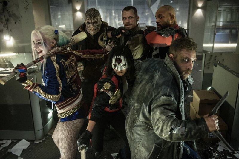 Will Smith, Adewale Akinnuoye-Agbaje, Joel Kinnaman, Jai Courtney, Margot Robbie, and Karen Fukuhara in Suicide Squad. Photo by Warner Bros.