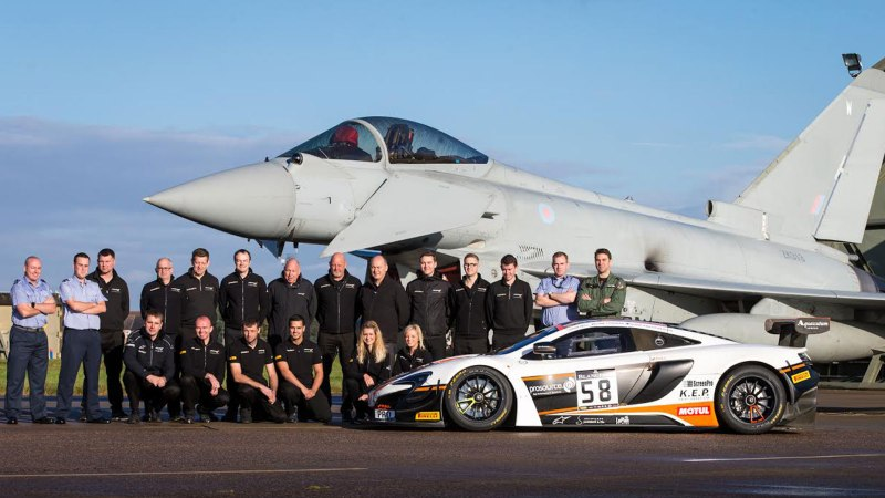 RAF and McLaren personnel with a McLaren GT car in front of a Typhoon at RAF Coningsby