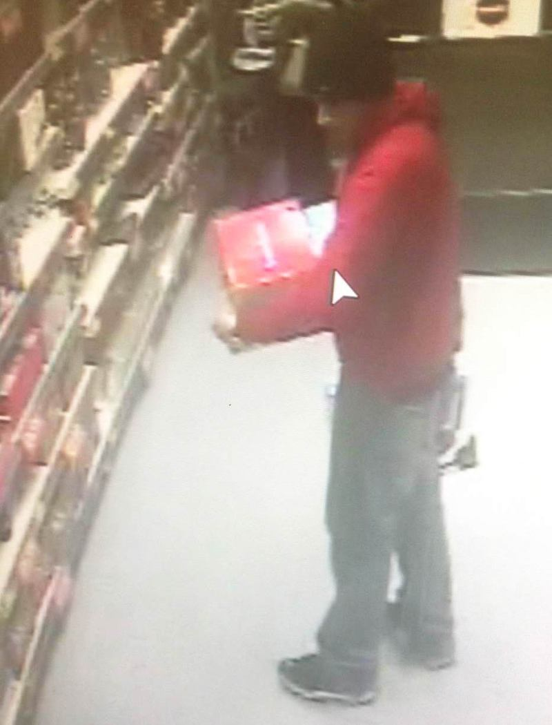 Police are looking for the man pictured in relation to the left of a a camera and speakers from B&M.