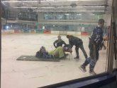 Hockey player crying in agony after breaking leg forced to wait two hours for ambulance