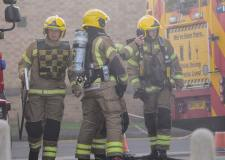 Crews rush to tackle freight train fire after brakes overheat